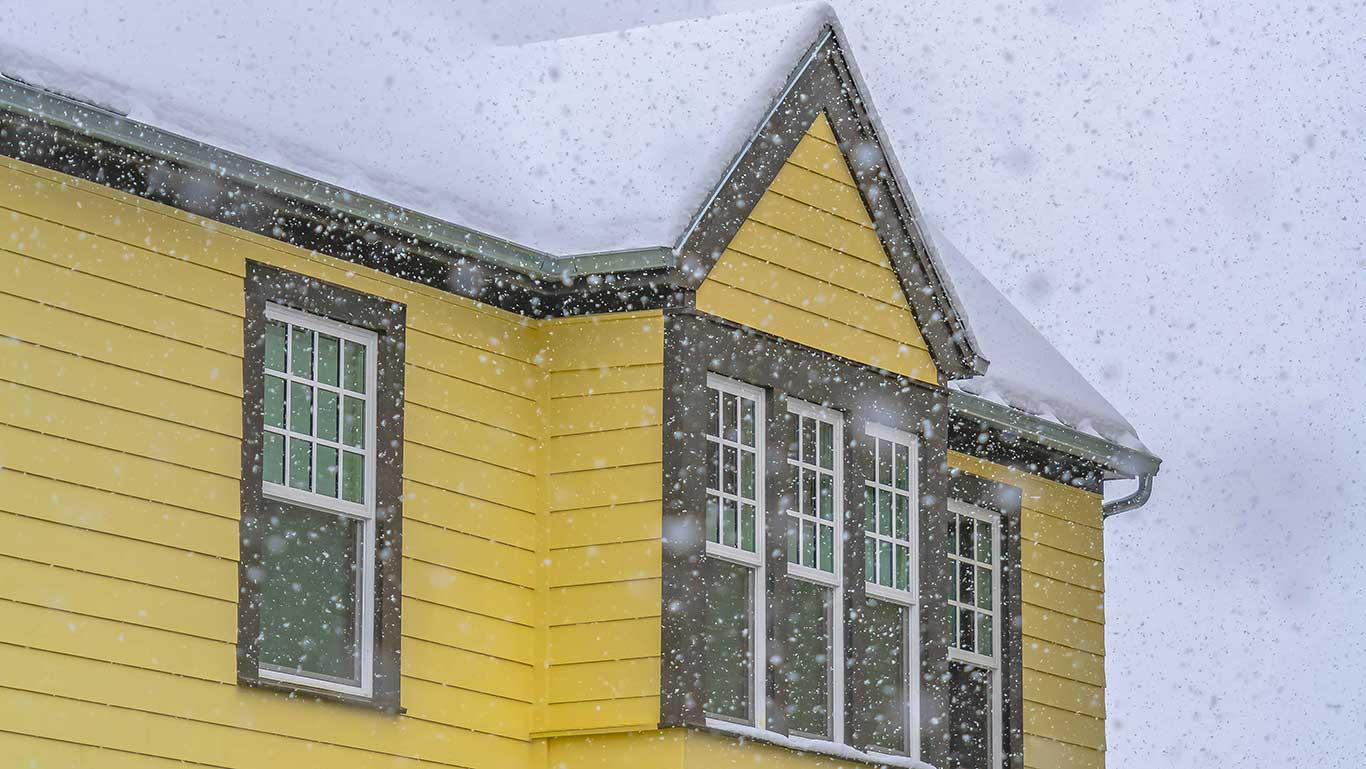 Yellow house and snow